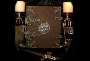 black magic book with spells