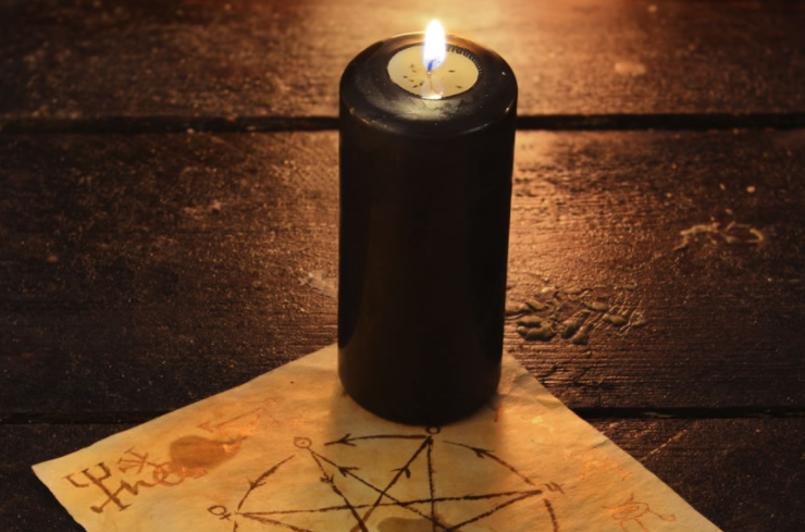 black candle for banishing spells