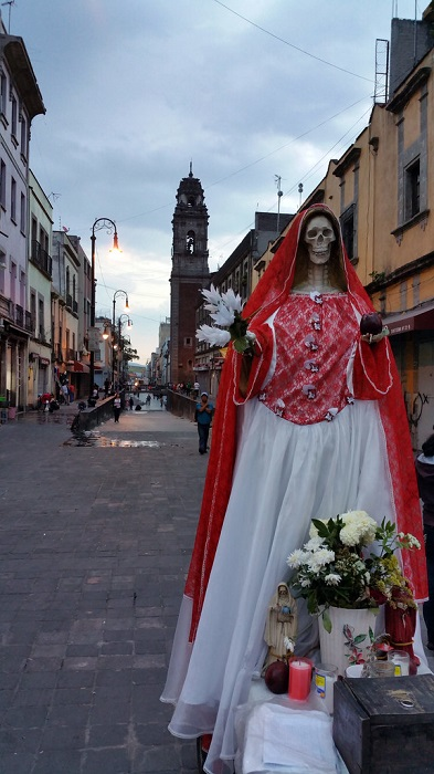 santa muerte on a street
