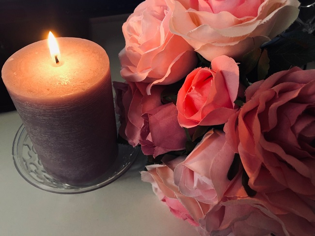self love spell candle and flower
