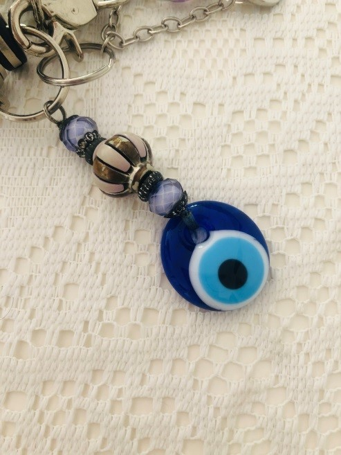 my evil eye amulet on a table